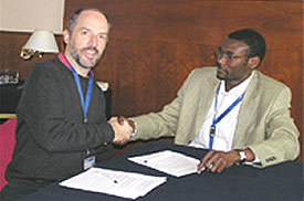 The Number Resource Organization (NRO) Chairman, Paul Wilson, and AfriNIC Project Manager, Adiel Akplogan.